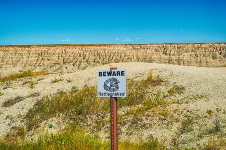 WPC, desert, rattlesnake, sign, badlands national park